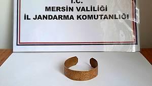 Mersin'de antik çağa ait altın bilezik ele geçirildi